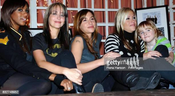 Members of All Saints ; Shaznay Lewis, Natalie Appleton, Melanie Blatt and Nicole Appleton, with Nicole's son Gene at a north London studio to...