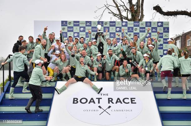 Members of all the Cambridge boat crews celebrate together after Cambridge win all the races on the day of the 165th annual men's boat race between...