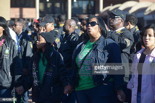 Members of Alpha Kappa Alpha Sorority Inc sing their sorority hymn during the 2014 Martin Luther King Jr March Rally at the King Center on January 20...