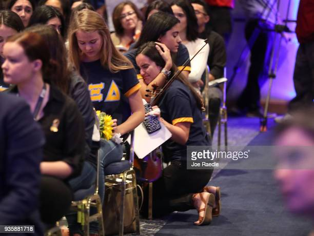 Members of Alpha Xi Delta sorority mourn for their sister Alexa Duran during a vigil for victims of last week's pedestrian bridge collapse on March...