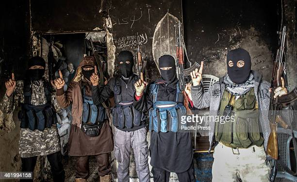 Members of alQaeda with covered face from different nationalities they are in an area called the Air Force Intelligence in Aleppo fighting with...