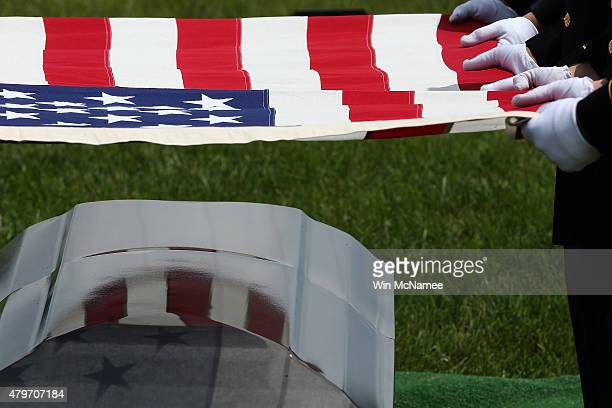 Members of am Old Guard burial team fold the American flag that rested upon the casket containing the remains of US Army Sgt Joseph Snock during the...