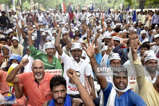 Members of Ambedkar Ekta Manch protest against the BJP Saffonization to stop the attacks on Muslims Dalits and OBC people in the name of religion at...