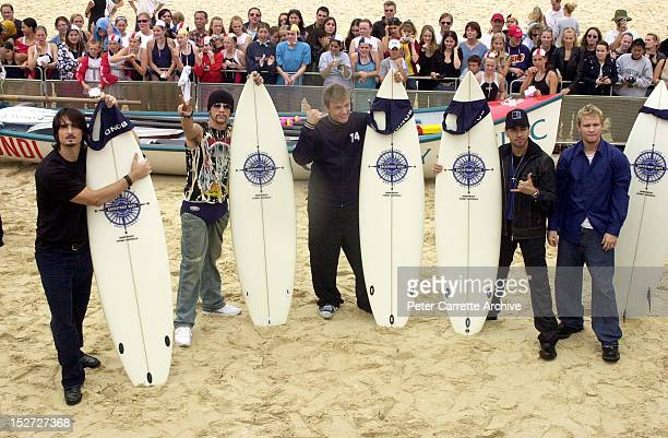Members of American boy band 'The Backstreet Boys' pose with surfboards at Bondi Beach during their 2 Day World Promo Tour on November 19 2000 in...