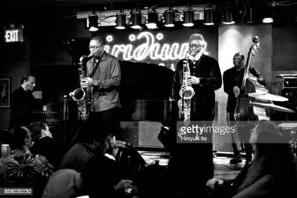 Members of American Jazz group the McCoy Tyner Quintet perform onstage at Iridium nightclub New York New York May 11 2004 Pictured are from left...
