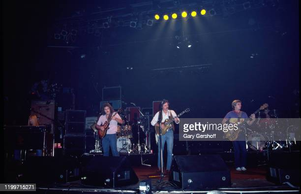 Members of American Rock and Country group the Allman Brothers Band perform onstage at the Capitol Theatre Passaic New Jersey December 16 1981...