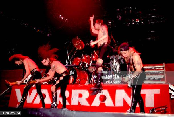 Members of American Rock group Warrant perform onstage at the Rosemont Horizon Rosemont Illinois November 5 1989 Pictured are from left Erik Turner...