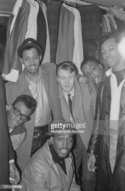 Members of American vocal group The Temptations backstage at the Apollo Theatre in New York City circa 1965