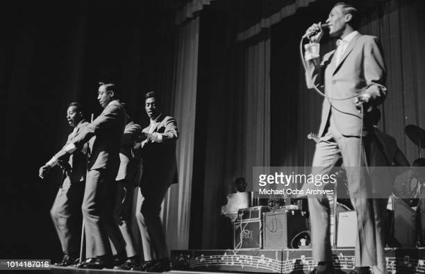 Members of American vocal group The Temptations perform at the Apollo Theatre in New York City circa 1965
