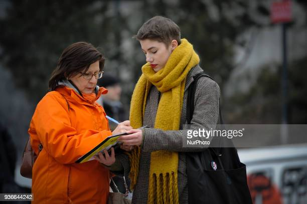 Members of Amnesty International are seen collecting signatures against the proposed abortion law in Warsaw Poland on March 22 2018 The proposed law...