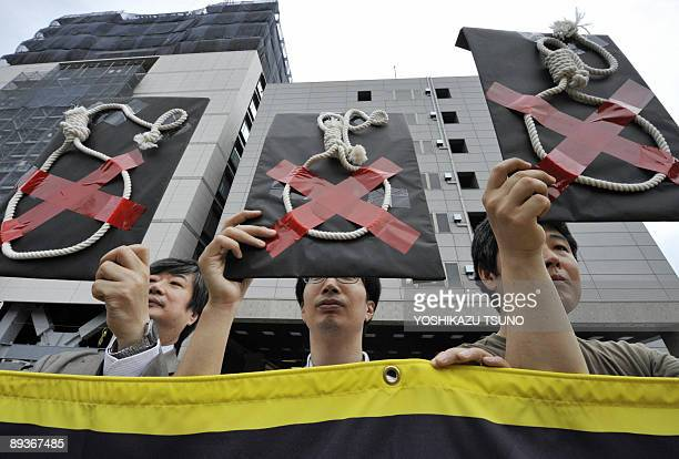Members of Amnesty International hold a rally to protest against Japan's death penalty in front of the national Diet in Tokyo on July 28 2009 Japan...