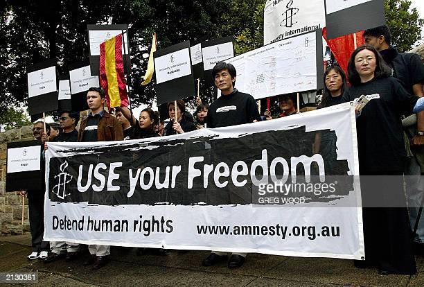 Members of Amnesty International protest outside the Sydney residence of Australian Prime Minister John Howard 01 July 2003 Amnesty International...