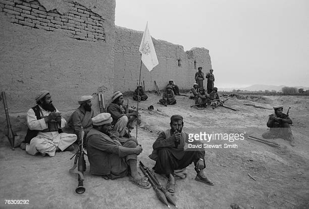Members of an Afghan Mujahideen group during a lull in an advance on Jalalabad Afghanistan March 1989 They are equipped with Kalashnikov assault...