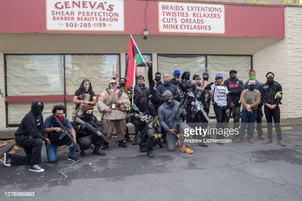 Members of an African American militia patrol a black neighborhood on a day when right wing Proud Boys hold a rally in the city on September 26, 2020...