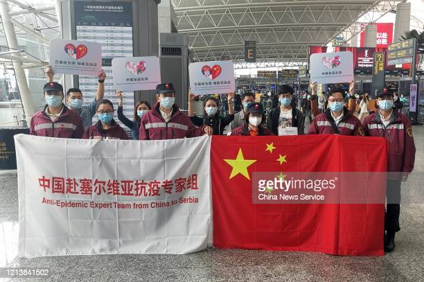 Members of an antiepidemic medical expert team pose for photos before their departure at Baiyun International Airport on March 21 2020 in Guangzhou...