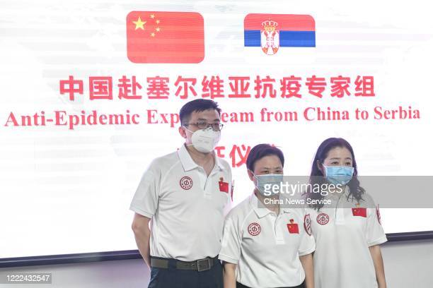 Members of an antiepidemic medical expert team pose for photos before their departure for Serbia on May 2 2020 in Guangzhou Guangdong Province of...