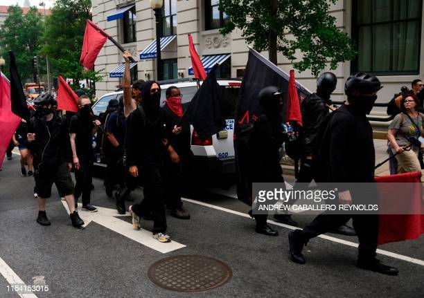 Members of an antifascist or Antifa group march as the AltRight movement gathers for a Demand Free Speech rally in Washington DC on July 6 2019