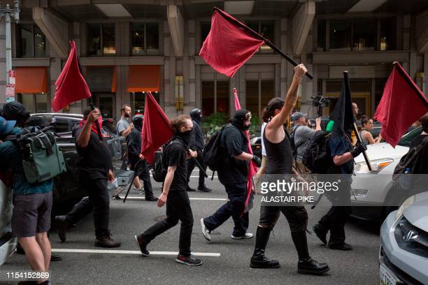 Members of an antifascist or Antifa march while the AltRight holds a Demand Free Speech rally in Washington DC July 6 2019
