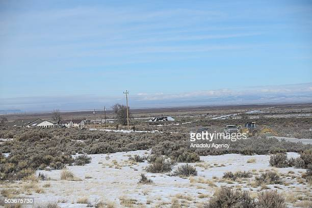 Members of an antigovernment militia gather around a campfire oustide of the Malheur National Wildlife Refuge Headquarters on January 6 2016 near...