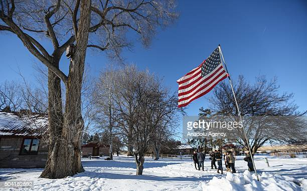 Members of an antigovernment militia gather outside of the Malheur National Wildlife Refuge Headquarters on January 8 2016 near Burns Oregon An armed...