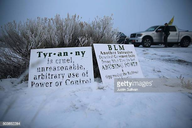 Members of an antigovernment militia stand guard outside of the Malheur National Wildlife Refuge Headquarters on January 7 2016 near Burns Oregon An...