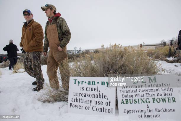 Members of an armed antigovernment militia monitor the entrance to the Malheur National Wildlife Refuge Headquarters near Burns Oregon January 5 2016...