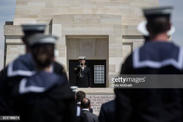 Members of an Australian Navy band stand at attention during the playing of the Last Post at the Lone Pine Cemetery and memorial on April 24, 2016 in...