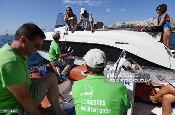 Members of an environmental protection association take part in a campagne called 'Zero plastic in the Mediterranean' to raise awareness of...