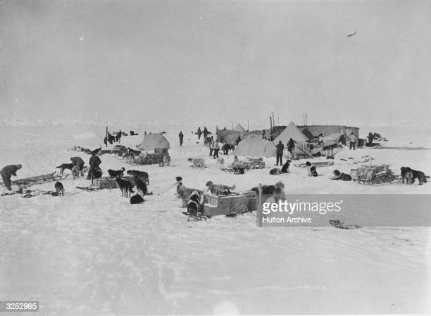 Members of an expedition team led by Irish explorer Sir Ernest Henry Shackleton at work at a camp site circa 1914 in Antarctica