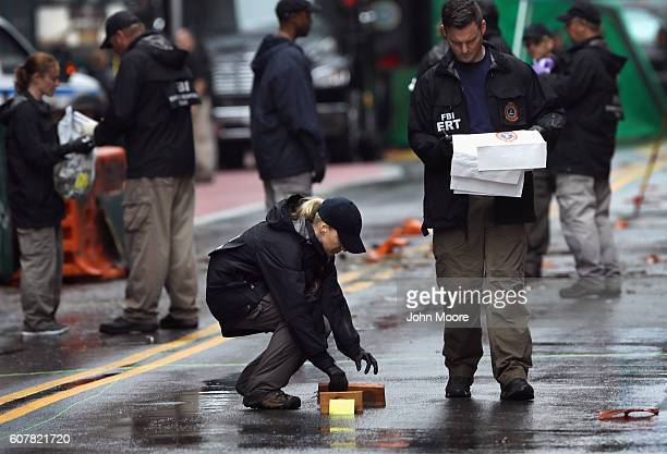 Members of an FBI Evidence Response Team collect pieces of evidence from the scene of bomb explosion in the Chelsea neighborhood on September 19 2016...