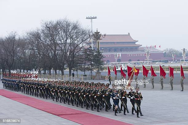 Members of an honor guard march during a welcoming ceremony for German President Joachim Gauck outside the Great Hall of the People on March 21 2016...