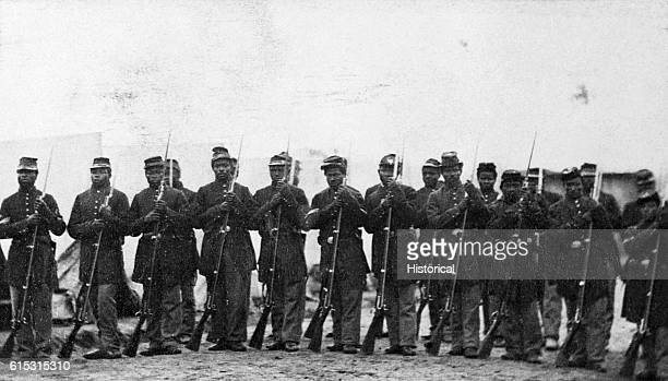 Members of an honor guard of black troops at Port Hudson Louisiana hold rifles with bayonets attached | Location Port Hudson Louisiana USA