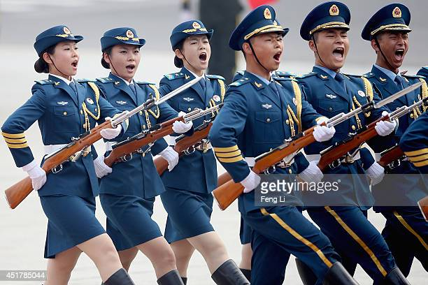Members of an honor guard shout as they march during a welcoming ceremony for German Chancellor Angela Merkel outside the Great Hall of the People on...