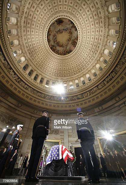 Members of an honor guard surround the casket of former US President Gerald Ford in the Rotunda of the US Capitol December 30 2006 in Washington DC...