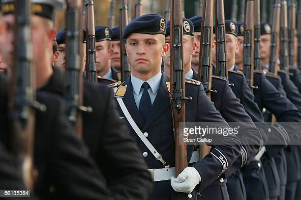 Members of an honour guard of the German armed forces the Bundeswehr march to their positions before the arrival of Chinese President Hu Jintao at...
