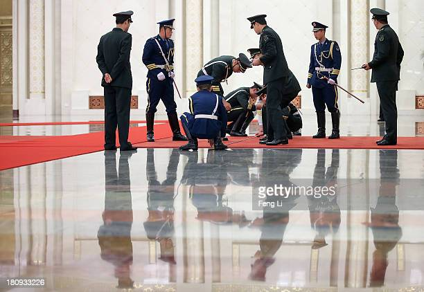 Members of an honour guard use tape measures on the floor to line up as they prepare for a welcoming ceremony for King Abdullah II Ibn Al Hussein of...