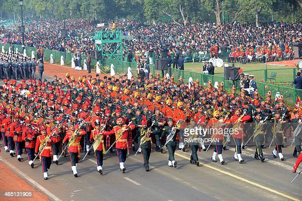 Members of an Indian Army band march during the Republic Day parade in New Delhi on January 26 2014 India celebrated its 65th Republic Day with a...