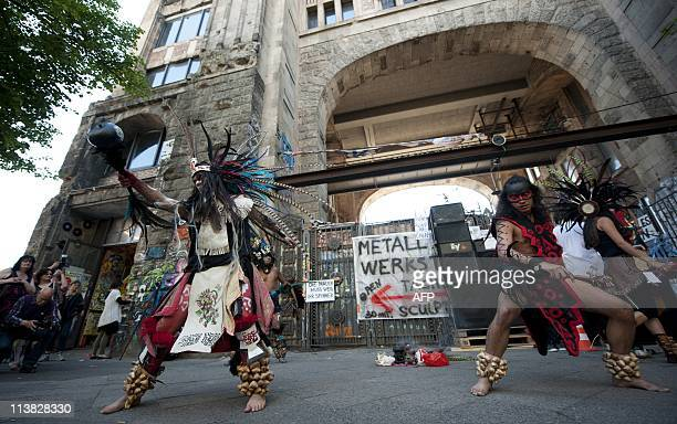 Members of an Indian dance group from South America perform in front of the Tacheles artist colony during a demonstration to support the institution...