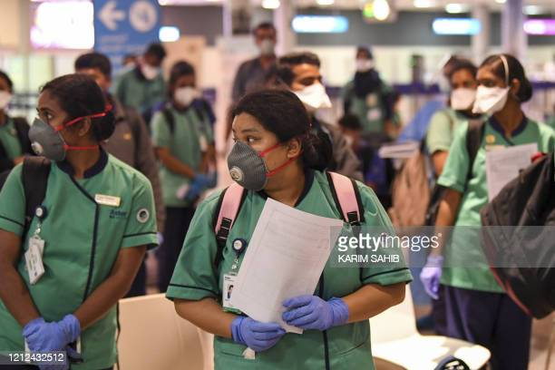 Members of an Indian medical team arrive at Dubai International Airport on May 9 to help with the coronavirus pandemic.