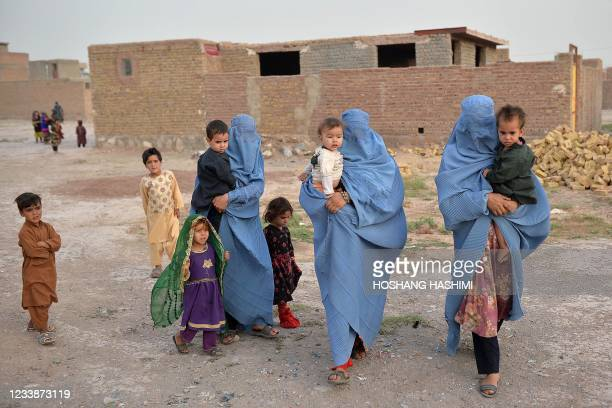 Members of an internally displaced Afghan family who left their home during the ongoing conflict between Taliban and Afghan security forces arrive...