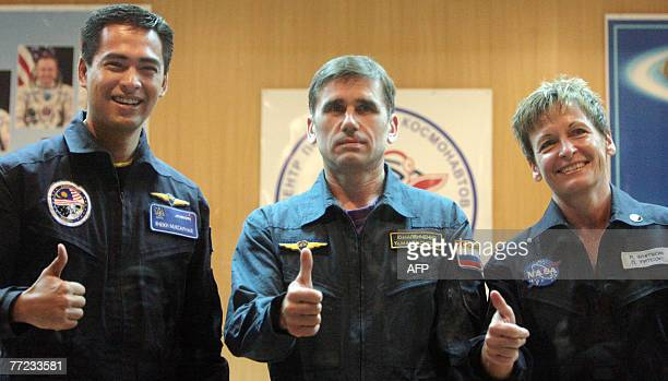 Members of an International space crew Sheikh Muszaphar Shukor of Malaysia Yury Malenchenko of Russia and Peggy Whitson of the United States pose...