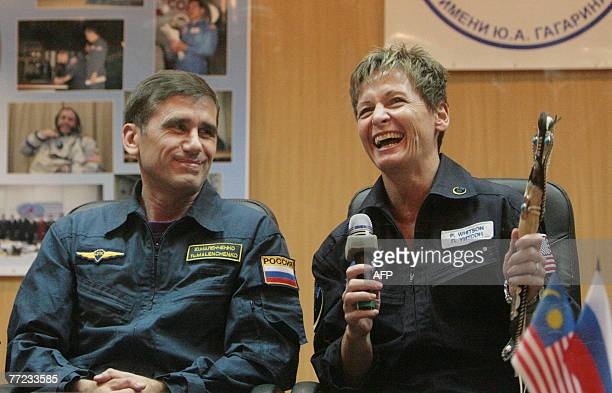 Members of an International space crew Yury Malenchenko of Russia and Peggy Whitson of the United States give after a news conference at Baikonur...