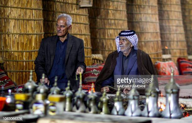 Members of an Iraqi clan gather inside a straw tent in the town of Mishkhab south of Najaf on November 15 2018 For centuries Iraqi clans have used...