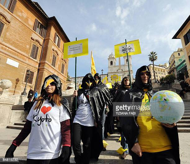 """Members of an Italian ecological association """"Legambiente"""" dress-up us a penguins and protest against pollution Piazza di Spagna in Rome on February..."""
