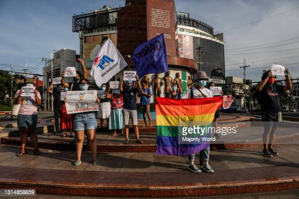 Members of an LGBT group hold placards as they protest against the early release of US soldier Joseph Scott Pemberton. President Rodrigo Duterte...