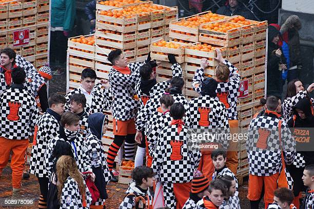 Members of an orange battle team take part in the traditional 'battle of the oranges' held during the Ivrea Carnival on February 7 2016 in Ivrea near...