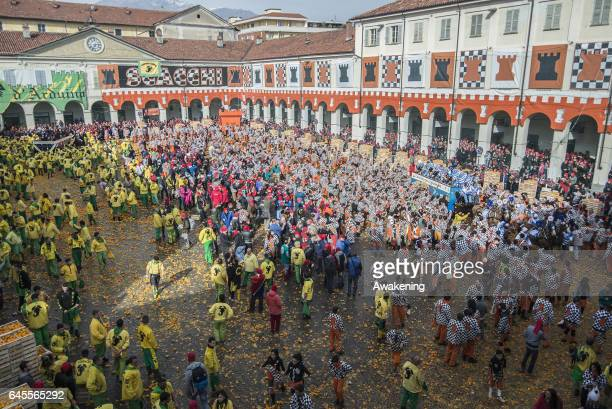 Members of an orange battle team take part in the traditional 'battle of the oranges' held during the Ivrea Carnival on February 26 2017 in Ivrea...
