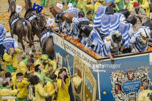 Members of an orange battle team takes part in the traditional 'battle of the oranges' held during the Ivrea Carnival on February 26 2017 in Ivrea...