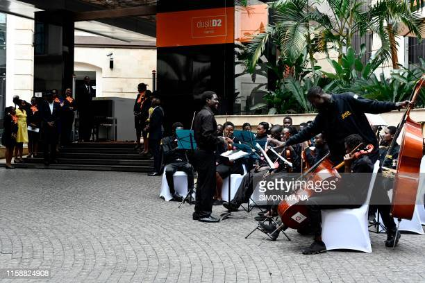 Members of an orchestra play music as DusitD2 hotel staff get ready to receive dignitaries during the reopening ceremony of the DusitD2 hotel on July...