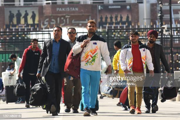 Members of an unauthorised Indian Kabaddi team return from Pakistan at the IndiaPakistan Wagah Border Post about 35 kms from Amritsar on February 17...